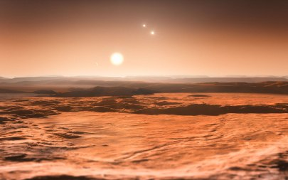 Artist's impression of the view from exoplanet Gliese 667Cd, looking towards the parent star with two of the super-Earths above right (click to enlarge) - Credit: ESO/M. Kornmesser